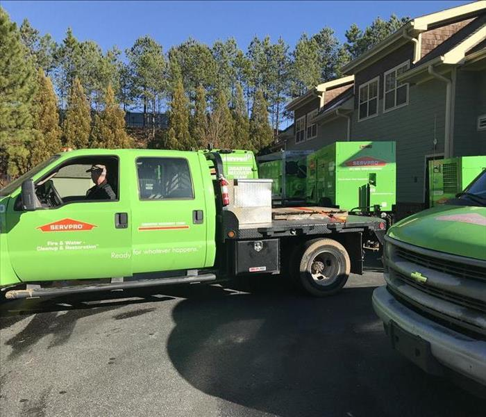 SERVPRO trucks out in front of a residential job