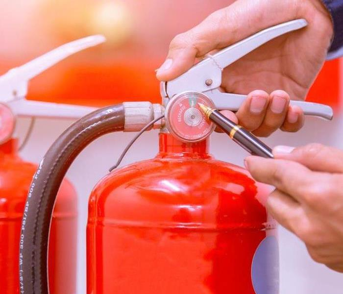 Fire Damage How To Properly Use a Fire Extinguisher: The PASS Method