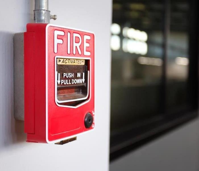 a fire alarm attached to a wall