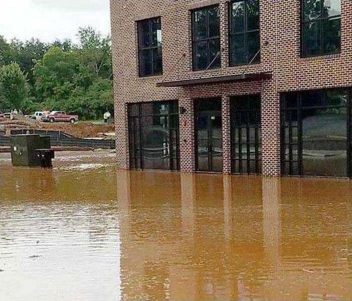 Flood waters surrounding a building